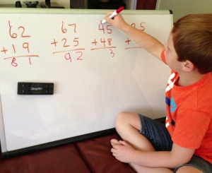 Ryan does math on the whiteboard