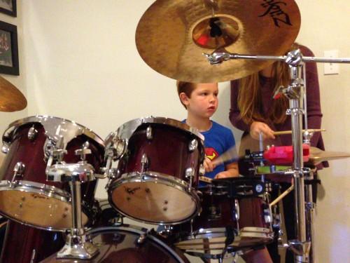 Ryan plays the drums